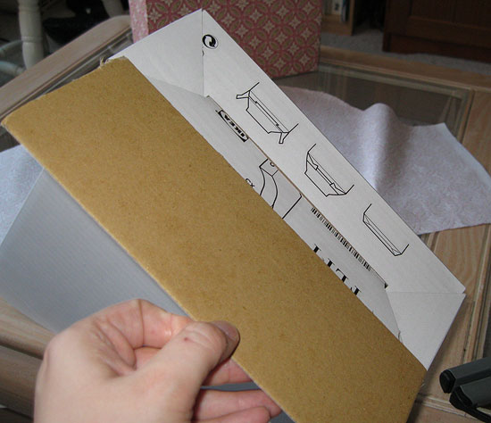 1. Cut out a piece of card board the same size as the base of the magazine file.