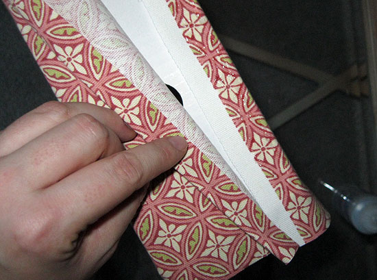 11. Fold other end of fabric so that the folded edge meets the corner of the magazine box.