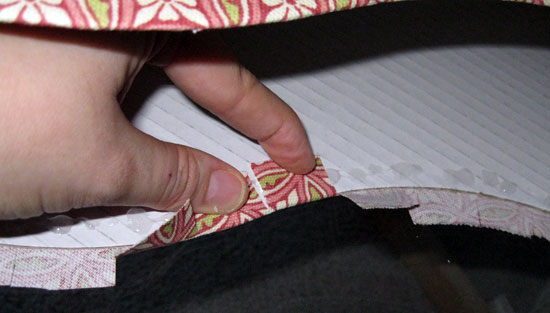 18. Apply glue to the inside of the magazine file. Pull fabric taut, and press clipped fabric into the glue.