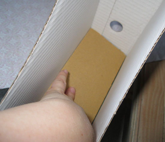 2. Insert cardboard into bottom of magazine file--this will keep the bottom from collapsing.