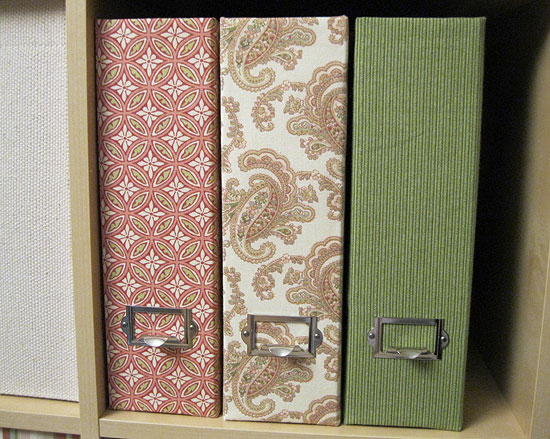 Three fabric-covered magazine files with label holders/finger pulls